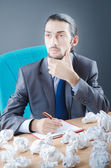 Businessman with lot of discarded paper — Stock Photo