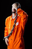 Inmate chained on black background — Stock Photo