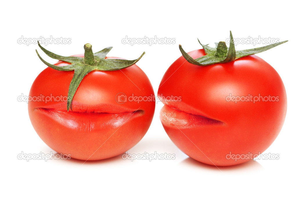 Two tomatoes with mouths  Stock Photo #7520481