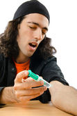Drug addict during injection — Stock Photo