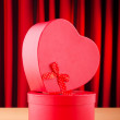 Foto Stock: Heart shaped gift box against background