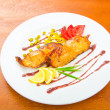 Fish fried and served in the plate — Stock Photo #7549325