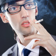 Young man smoking cigarette — Stock Photo #7549731