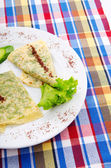 Herb stuffed pancaces in the plate — Stock Photo
