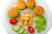 Plate with burgers and french fries — Stock Photo