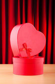 Heart shaped gift box against background — Stok fotoğraf