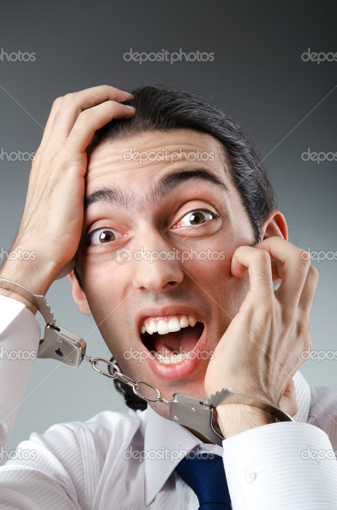 Businessman handcuffed for his crimes — Stock Photo #7549366