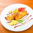 Fish fried and served in the plate — Stock Photo #7550870