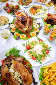 Table served with tasty meals — Stock Photo