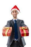 Office worker offering giftbox on white — Stockfoto