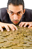 Businessman with golden coins — Stock Photo