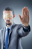 Businessman blinded with money — Stock Photo