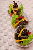 Tasty salad served in glasses — Stock Photo