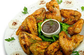 Chicken wings barbeque in the plate — Stock Photo