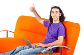 Student working with laptop sitting on sofa — Stock fotografie