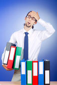 Businessman with many office folders — Stock Photo