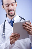 Doctor working on the tablet — Stock Photo