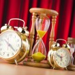 Alarm clocks and hourglass in time concept - Stockfoto