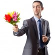 Young man with tulip flowers — Stock Photo #7883139