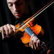 Violin player playing the intstrument — Stock Photo #7887899