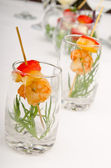 Glasses with king prawns — Stock Photo