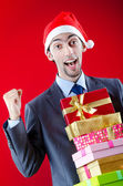 Businessman offering gifts on christmas — Stok fotoğraf