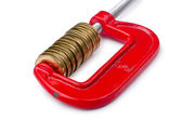 Business concept with clamp and coins isolated — Stock Photo