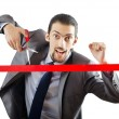 Businessman crossing finish line — Stock Photo