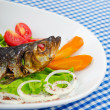 Stock Photo: Fried fish in the plate