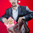 Businessman celebrating christmas holidays - Stock Photo