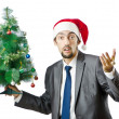 Businessman with christmas tree on white — Stock Photo #7892867