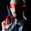 Man cutting ribbon on his eyes — Stock Photo #7893402