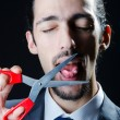 Cutting tongue with scissors - Stock Photo