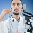 Chemist working with microscope — Stock Photo