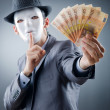 Businessman with money and mask — Stock Photo