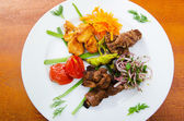 Plate with tasty lamp kebabs — Stock fotografie