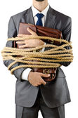 Businessman tied up on white — Stock Photo
