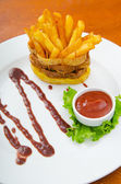 French fries served with ketchup — Stock Photo