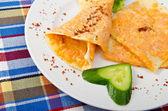 Pumpkin stuffed panckes in the plate — Stock Photo