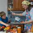 Amicable family on kitchen. — Stock Photo #7094990