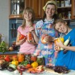 Amicable family on kitchen. — Stock Photo #7094991