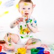 Baby and paints — Stock Photo #7095631