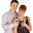 Young loving couple with red wine glasses in hands — Stock Photo