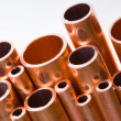 Stock Photo: Copper pipes of different diameter
