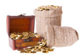 Wooden chest and two bags filled with coins — Stock Photo