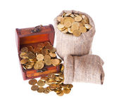 Wooden chest and two bags filled with coins — Stockfoto