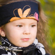 Little girl in a black leather jacket and bandana — Stock Photo #7869621