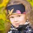 Little girl in a black leather jacket and bandana — Stock Photo #7869626