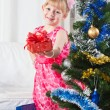 Girl with gifts near a New Year tree — Stock Photo