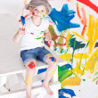 Girl in a cap with paints — Stock Photo #7869715